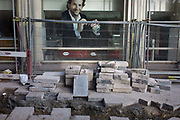The actor Bradley Cooper, the first celebrity to appear in a Häagen-Dazs campaign, endorses the ice cream brand with paving stone hole in central London. Piled up in the foreground are paving stones slabs that are being replaced after an energy renewal project on Leicester Square in the capital's West End.