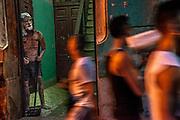 Havana, Cuba. July 2015. A sculpture of Sait Lazar looks out as people pass by.