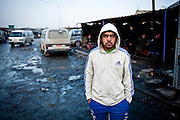 Mustafa, a day laborer in Sadr City. Mustafa's father is disabled, and as the oldest child, he cares for his parents and siblings on the meager wages he earns from infrequent construction jobs.