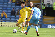 Oxford United midfielder James Henry (17)  looks to release the ball during the EFL Sky Bet League 1 match between Oxford United and Coventry City at the Kassam Stadium, Oxford, England on 9 September 2018.