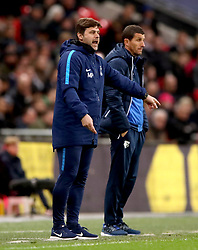 Tottenham Hotspur manager Mauricio Pochettino (left) and Watford manager Javi Gracia watch the action from the touchline