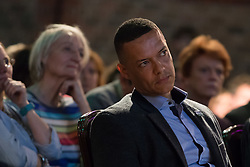 © Licensed to London News Pictures. 15/05/2017. LONDON, UK. CLIVE LEWIS, Labour Party MP listens to speeches at the Progressive Alliance launch in London. The Progressive Alliance is a cross political party group who are campaigning against the Tories and encouraging tactical voting in the general election.  Photo credit: Vickie Flores/LNP