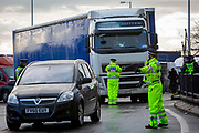 Police manage the traffic into the port as tensions are high between them and drivers who have been waiting over 48 hours for the Port of Dover to re-open, on the 23rd of December 2020, Dover, Kent, United Kingdom. The French border was closed due to a new strain of COVID-19 all travellers are now waiting to receive a COVID-19 test before they can board a ferry to Calais, France. Dover is the nearest port to France with just 34 kilometres (21 miles) between them. It is one of the busiest ports in the world. As well as freight container ships it is also the main port for P&O and DFDS Seaways ferries.  (photo by Andrew Aitchison / In pictures via Getty Images)