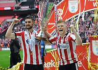 Football - 2018 Checkatrade (EFL) Trophy - Lincoln City vs. Shrewsbury Town<br /> <br /> Lincoln goalscorer, Elliot Whitehouse (right) and Captain, Luke Waterfall celebrate with the trophy, at Wembley Stadium.<br /> <br /> COLORSPORT/ANDREW COWIE