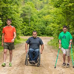 Three men explore the new Bethel Community Forest in Bethel, Maine.