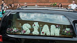 © licensed to London News Pictures. 18/04/2011. Swindon, UK. Hundreds of people line the streets of Old Town Swindon, Wilts today (18/04/2011) as The funeral cortege carrying the coffin of murder victim SIan O'Callaghan passes on its way to a private service. The body of the 22 year-old PA was found in wooded area n Uffington, Oxfordshire following her disappearance while on a night out in Swindon.  Please see special instructions for usage rates. Photo credit should read Ben Cawthra/LNP