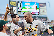 Oakland Athletics left fielder Jonny Gomes is congratulated by his teammates after hitting a grand slam against the Minnesota Twins on July 13, 2012 at Target Field in Minneapolis, Minnesota.  The Athletics defeated the Twins 6 to 3.  © 2012 Ben Krause