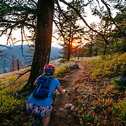 Heather Goodrich rides off into the sunset near the town of Jackson Wyoming.