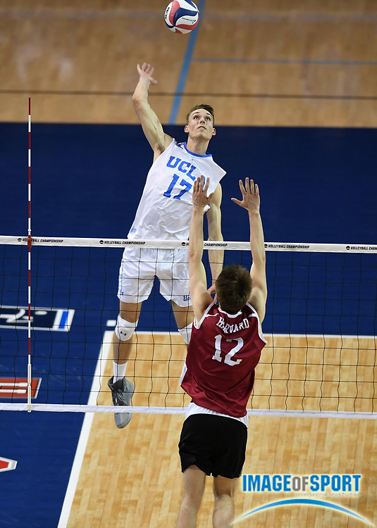UCLA Bruins opposite hitter Christian Hessenauer (17) spikes the ball as Harvard Crimson outside htter Jack Heavey (12) defends during the opening round game of the NCAA college volleyball championship in Los Angeles, Tuesday, May 1, 2018. UCLA defeated Harvard 23-25, 25-21, 25-11, 25-21.