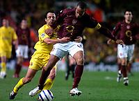 Photo: Alan Crowhurst.<br />Arsenal v Villarreal. UEFA Champions League. Semi-Final, 1st Leg. 19/04/2006. Arsenal's Thierry Henry (R) is held back by Quique Alvarez.