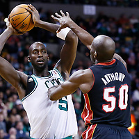 27 January 2013: Boston Celtics power forward Kevin Garnett (5) looks to pass the ball over Miami Heat center Joel Anthony (50) during the Boston Celtics 100-98  2OT victory over the Miami Heat at the TD Garden, Boston, Massachusetts, USA.