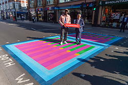© Licensed to London News Pictures. 16/09/2021. London, UK.  Artist YINKA ILORI and Mayor of London, Sadiq Khan unveil Bring London Together, a spectacular new public art commission transforming 18 pedestrian crossings with distinctive playful designs. The 'Bring London Together' project is designed to draw Londoners and visitors to central London and support the capital's creative, retail and hospitality sectors which have been disproportionately affected by the pandemic. It is the latest instalment of the Mayor's Let's Do London tourism campaign–the largest domestic tourism campaign the capital has ever seen. Photo credit: Ray Tang/LNP