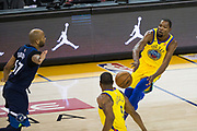 Golden State Warriors forward Kevin Durant (35) passes to Golden State Warriors forward Andre Iguodala (9) against the Minnesota Timberwolves at Oracle Arena in Oakland, Calif., on January 25, 2018. (Stan Olszewski/Special to S.F. Examiner)