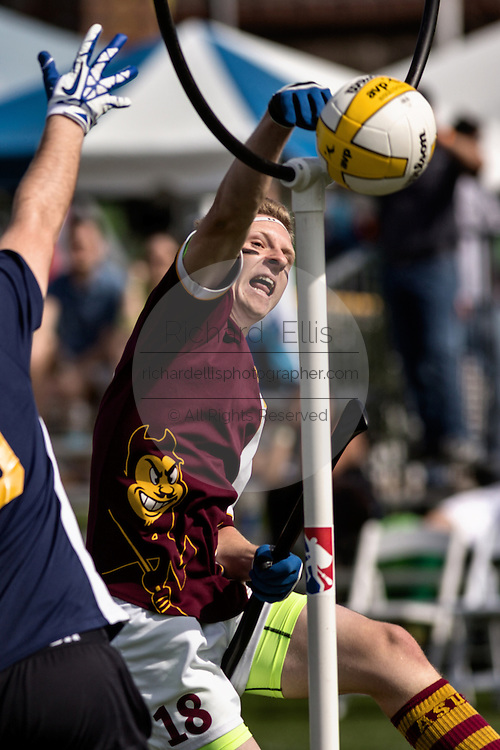 Game action during the Quidditch World Cup on April 5, 2014 in Myrtle Beach, South Carolina. The sport, created from the Harry Potter novels is a co-ed contact sport with elements from rugby, basketball, and dodgeball. A quidditch team is made up of seven athletes who play with broomsticks between their legs at all times.