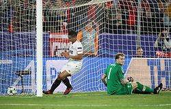 Sevilla's Wissam Ben Yedder collects the ball after scoring his side's second goal from the penalty spot