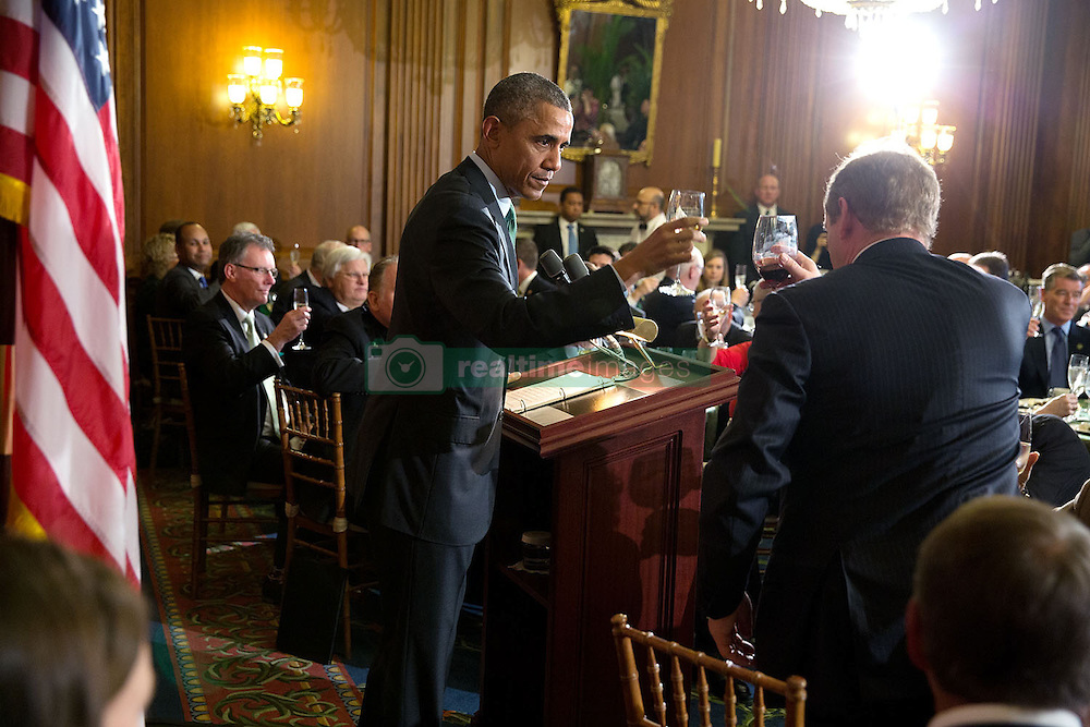 President Barack Obama delivers a toast during a St. Patrick's Day lunch with Prime Minister (Taoiseach) Enda Kenny of Ireland at the U.S. Capitol in Washington, D.C., March 17, 2015. (Official White House Photo by Pete Souza)<br /> <br /> This official White House photograph is being made available only for publication by news organizations and/or for personal use printing by the subject(s) of the photograph. The photograph may not be manipulated in any way and may not be used in commercial or political materials, advertisements, emails, products, promotions that in any way suggests approval or endorsement of the President, the First Family, or the White House.