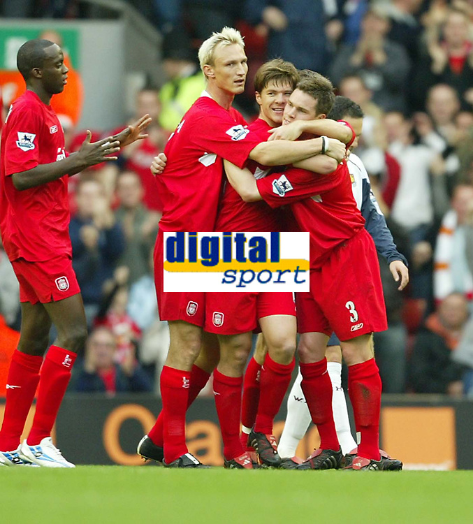 Photo: Aidan Ellis.<br /> Liverpool v West Ham Utd. The Barclays Premiership.<br /> 29/10/2005.<br /> Liverpool's Xabi Alonso celebrates his goal the first of the game with Steve Finnan and Sami Hyppia