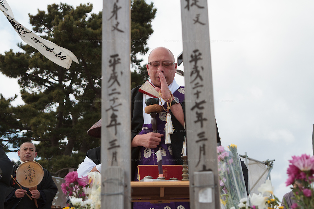 Buddhist Monks perform a ceremony at a Shinto shrine on Hiyori yama  or Weather Hill to remember victims of the tsunami at  Miyagi, Japan. Friday March 11th 2016. 2016 marks the fifth anniversary of the Great East Japan earthquake. This magnitude 9 quake caused a tsunami that flattened large parts of the Tohoku coast killing around 18,000 people and triggering a nuclear disaster at Fukushima Daichi Power Station.