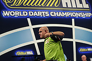 Michael van Gerwen wins his fourth round  match against Adrian Lewis and leaves the stage during the World Darts Championships 2018 at Alexandra Palace, London, United Kingdom on 27 December 2018.