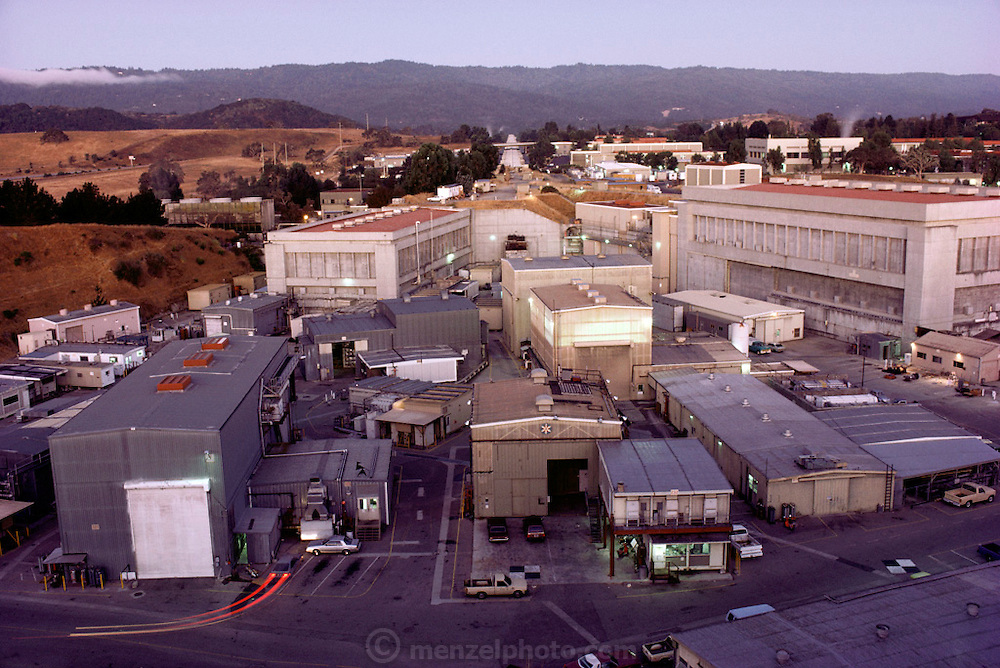 Physics: Stanford Linear Accelerator Center (SLAC). Main complex. (1986) 3. 2 km (2 mile) long linear accelerator at the Stanford Linear Accel- erator Center (SLAC), California. The end at which the electrons start their journey is in the distance; the experimental areas where the accelerated electrons are smashed into targets, or used for further acceleration in electron-positron Colliders, is in the group of buildings seen here. The giant red- roofed building in the experimental area is End Station A, where the first evidence of quarks was discovered in 1968-72. .Stanford Linear Collider (SLC) experiment, Menlo Park, California. With a length of 3km, the Stanford Linear Accelerator is the largest of its kind in the world. The accelerator is used to produce streams of electrons and positrons, which collide at a combined energy of 100 GeV (Giga electron Volts). This massive energy is sufficient to produce Z-zero particles in the collision. The Z-zero is one of the mediators of the weak nuclear force, the force behind radioactive decay, and was first discovered at CERN, Geneva, in 1983. The first Z-zero at SLC was produced on 11 April 1989.