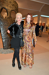 Left to right, AMANDA ELIASCH and HENRIETT TUNOGI at the Masterpiece Marie Curie Party supported by Jeager-LeCoultre held at the South Grounds of The Royal Hospital Chelsea, London on 30th June 2014.