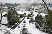 © Licensed to London News Pictures. 19/01/2013. Kew, UK A view of the garden's famous glass houses from the Treetop walkway. People enjoy the snow at Kew Gardens in West London today 19th January 2013. More cold weather and snow are expected over the coming days.  Photo credit : Stephen Simpson/LNP