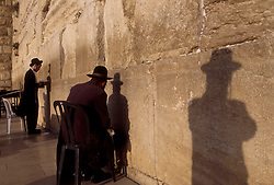 EAST JERUSALEM - Orthodox Jews pray at the Western Wall, despite the ongoing violence, which has kept many of the faithful away. Control over East Jerusalem, where many of the holiest sites of the Jewish, Muslim and Christian faiths are located, continues to be a major point of contention in the ongoing peace negotiations. (Photo © Jock Fistick)
