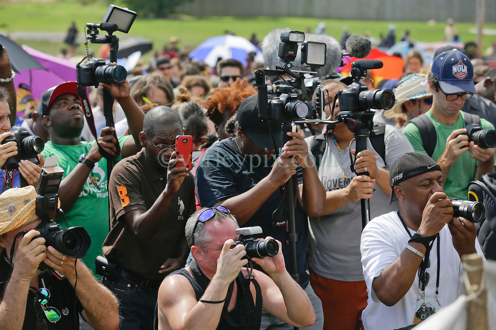 29 August 2015. Lower 9th Ward, New Orleans, Louisiana.<br /> Hurricane Katrina 10th anniversary memorial.<br /> The media descended on New Orleans to cover events surrounding the 10th anniversary. Seen here at the levee wall which gave way a decade earlier. <br /> Photo credit©; Charlie Varley/varleypix.com.