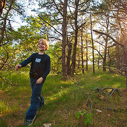 A young boy and girl hiking at the Biddle Property in Wellfleet, Massachusetts. Cape Cod National Seacshore.