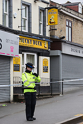 © Licensed to London News Pictures . 26/03/2015 . Rochdale , UK . Police cordon around the Mucky Duck pub on Drake Street , Rochdale , this morning ( Thursday 26th March ) as overnight a man has died following a fight that spilled out from the pub . Police arrested two men at the scene . Photo credit : Joel Goodman/LNP