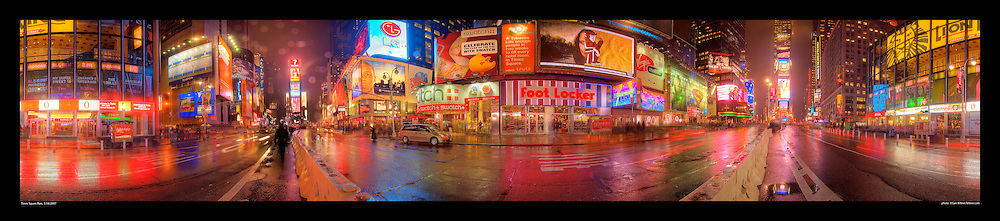 Panoramic photograph of Times Square, New York City shot on a rainly night.  Print Size (in inches): 15x3.5; 24x5.5; 36x8; 48x11; 60x13; 72x16.