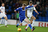 Aron Gunnarsson of Cardiff city  goes past Nathan Baker of Aston Villa. EFL Skybet championship match, Cardiff city v Aston Villa at the Cardiff City Stadium in Cardiff, South Wales on Monday 2nd January 2017.<br /> pic by Andrew Orchard, Andrew Orchard sports photography.