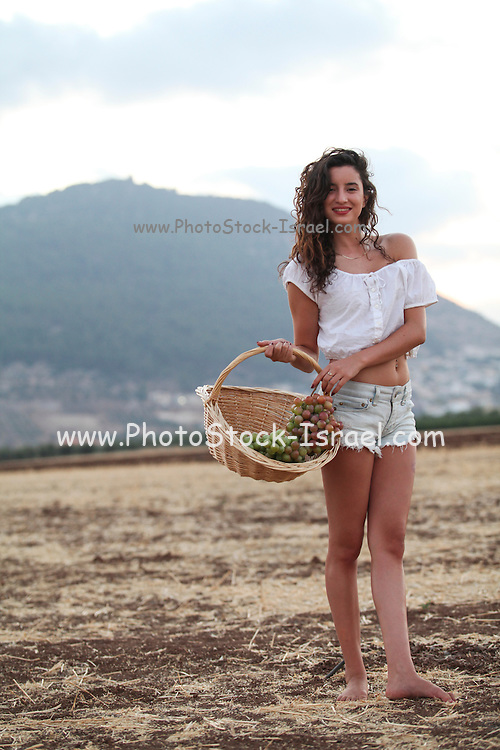 Young teen girl during harvest Model release available