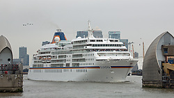 © Licensed to London News Pictures. 07/09/2014. Cruise ship Europa departs the Thames as a tall ships festival continues. The biggest tall ships event in London for 25 years is continuing across this weekend. Visitors took the opportunity to sail in tall ships up and down the Thames and go onboard those moored at Greenwich and Woolwich. The Royal Greenwich Tall Ships Festival concludes on Tuesday when all 50 vessels will sail down river together. Credit : Rob Powell/LNP