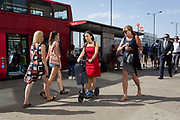 Commuters walk southwards over London Bridge, from the City of London - the capitals financial district founded by the Romans in the 1st century - to Southwark on the south bank, on 6th August 2018, in London, England.