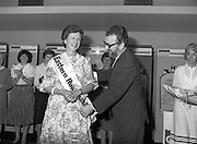 """Calor Kosangas Housewife of the Year - Dublin Regional Final.26/10/1982  26.10.1982..""""Calor Kosangas Housewife Of The Year 1982"""". Dublin Regional Final..The final was held in the Gresham Hotel,O'Connell St,Dublin. The winner was Mrs.,Deirdre Ryan,Derrypatrick,Drumree,Co Meath..Mr Michael Higgins ,Marketing and General Sales Manager,Calor Kosangas presents the winners' sash to Mrs.Deirdre Ryan, derrypatrick,Drumree,Co Meath"""