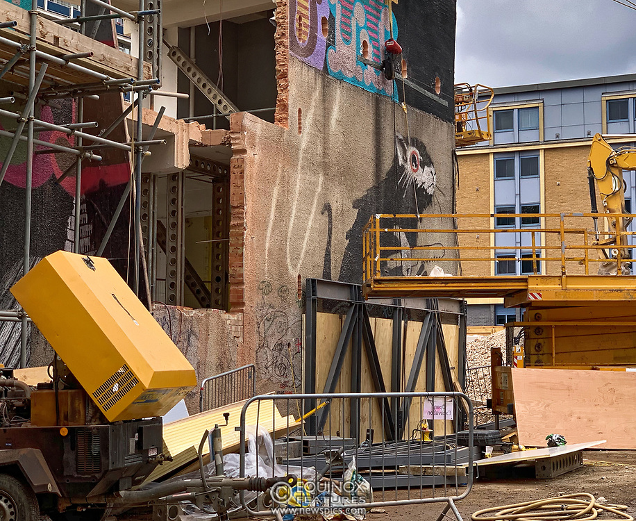 London, United Kingdom - 9 September 2019<br /> EXCLUSIVE SET - Aerial construction specialists and demolition experts use a huge crane to carefully lift intact, a twenty five ton, two-story wall, to preserve a famous Banksy rat image which has been covered up for years. Teams from specialist companies have spent over six weeks cutting around the artwork and fitting custom made eight ton steel supports to enable them to save the historic piece of art. Work has started on the construction of a new twenty seven floor art'otel hotel on the site of the old Foundry building in Shoreditch, east London, and a condition of the planning permission was to preserve the historical Banksy graffiti. A second section of the painting, an image of a TV being thrown through a broken window has already been cut out and moved separately. After the hotel construction is complete the two parts of the Banksy painting will be displayed on the hotel. Our pictures show the stages of work to protect the image, culminating in the lifting of the three story wall by crane. Video footage also available.<br /> (photo by: EQUINOXFEATURES.COM)<br /> Picture Data:<br /> Photographer: Equinox Features<br /> Copyright: ©2019 Equinox Licensing Ltd. +443700 780000<br /> Contact: Equinox Features<br /> Date Taken: 20190909<br /> Time Taken: 143131<br /> www.newspics.com