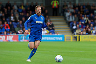 AFC Wimbledon midfielder Scott Wagstaff (7) dribbling during the EFL Sky Bet League 1 match between AFC Wimbledon and Rochdale at the Cherry Red Records Stadium, Kingston, England on 5 October 2019.