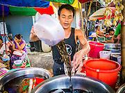 16 JUNE 2013 - YANGON, MYANMAR: A juice vendor works in a market in Yangon. Yangon, formerly Rangoon, is the largest city in Myanmar. It is the former capital of the Southeast Asian country. It's still Myanmar's economic capital.      PHOTO BY JACK KURTZ