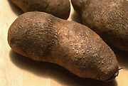 Close up photograph of some Yams tubers on a table