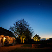 Clear winter evening outside a farmhouse in the Cotswolds near Stroud, England.