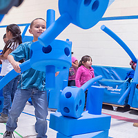 Uriah Hernandez and other children play with new portable playground equipment at the Boys and Girls Club in Gallup Wednesday.