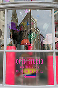 A detail of a shop and studio window selling hats on All Saints Road in Notting Hill, on 7th October 2018, in London, England.