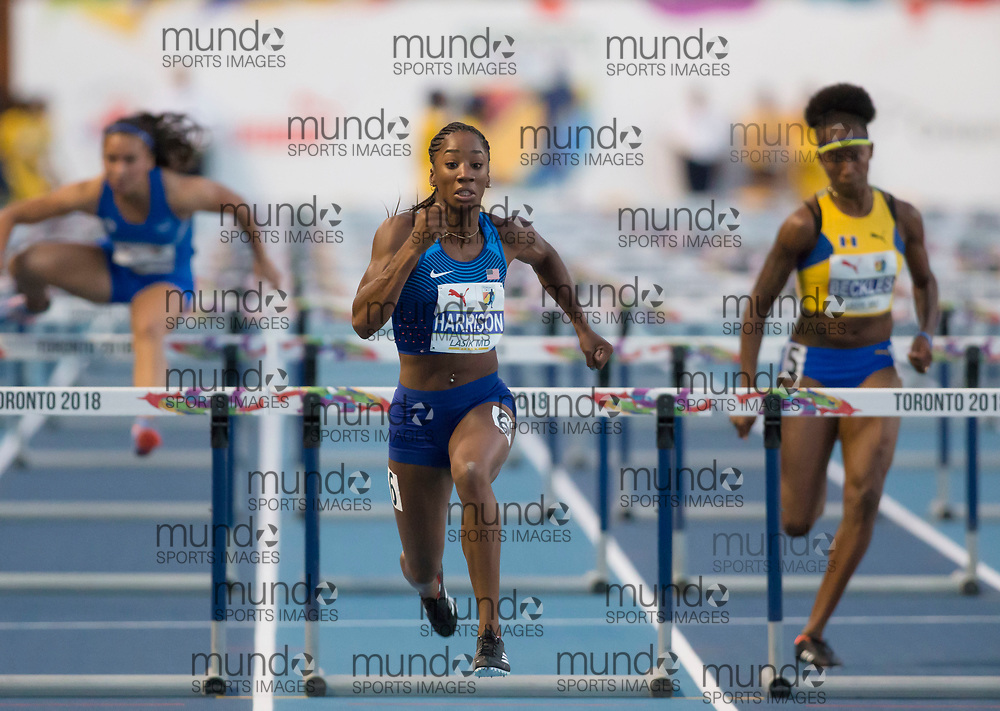 Toronto, ON -- 10 August 2018: Left to right, Nancy Gabriela Sandoval Moreira (El Salvador), Kendra Harrison (USA), Kierre Beckles (Barbados), 100m hurdles semi-final at the 2018 North America, Central America, and Caribbean Athletics Association (NACAC) Track and Field Championships held at Varsity Stadium, Toronto, Canada. (Photo by Sean Burges / Mundo Sport Images).