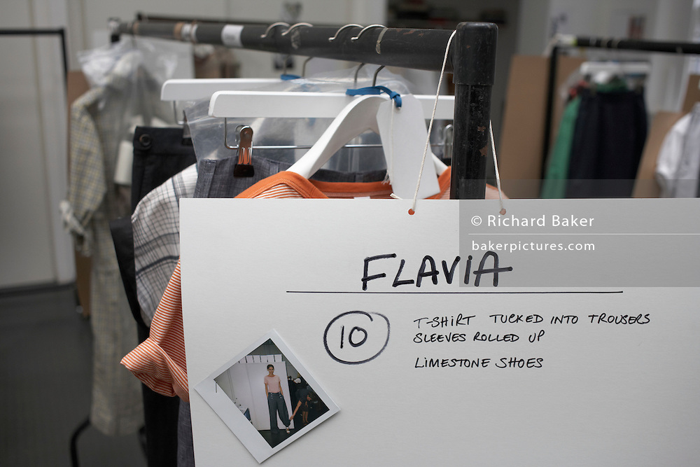 Polaroid print for fashion model Flavia de Oliveira on a rack of her clothes to wear at designer Margaret Howell's Autumn show