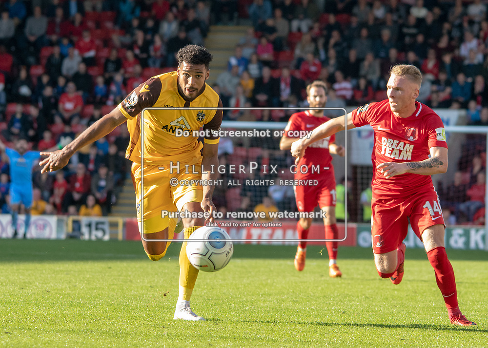 LONDON, UK - SEPTEMBER 29: Jonah Ayunga (Sutton Utd) attacking with Myles Judd (Leyton Orient) during the Vanarama National League match between Leyton Orient and Sutton United at The Breyer Group Stadium on September 29, 2018 in London, UK. (Photo by Jon Hilliger)