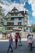 The Schloss (castle) building, east of the Postplatz in Appenzell village, Switzerland, Europe. The Schloss has been privately owned since 1708 by the Sutter family, who still reside there, and it is not open to the public. Right next to the castle is the Convent of Mary the Angel, which was built by the Capuchin religious order in the early 1680s. For licensing options, please inquire.