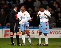 Photo: Javier Garcia/Back Page Images Mobile 07887 794393<br />03/01/2005 Crystal Palace v Aston Villa, FA Barclays Premiership, Selhurst Park<br />Peruvian Nolberto Solano acts as translator as Ecuadorian Ulises De La Cruz is about to be booked by Andy D'Urso