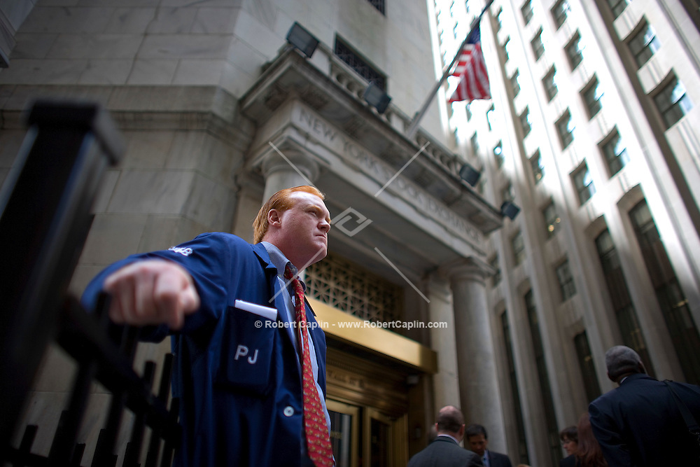 Broker Terry Toal outside the New York Stock Exchange on a turbulent day in the financial world.   Lehman Brothers, burdened by $60 billion in soured real-estate holdings, filed a Chapter 11 bankruptcy petition in U.S. Bankruptcy Court after attempts to rescue the 158-year-old firm failed. Bank of America Corp. said it is snapping up Merrill Lynch & Co. Inc. in a $50 billion all-stock transaction. Sept 15, 2008.