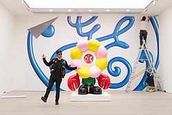 "© Licensed to London News Pictures. 29/10/2020. London, UK. Artist Phillip Colbert posing with his art installation titled Lobster Flower (2020) at the press preview of his exhibition ""Lobsteropolis"" showing at the Saatchi gallery. Photo credit: Ray Tang/LNP"